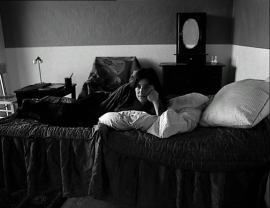 "Chantal Akerman, actor and auteur, gazes at ""the audience"" in je tu il elle-- or does she?"